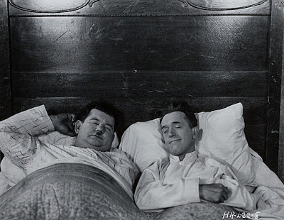 Laurel and Hardy in bed together